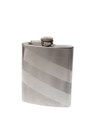 Closed shiny metal flask for liquids, isolated on white background