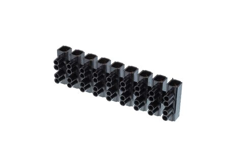 Black plastic electrical terminal block, isolated on white background