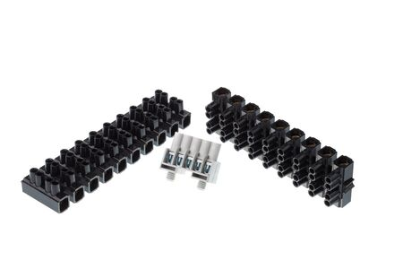 Set of gray and black plastic electrical terminal block, isolated on white background