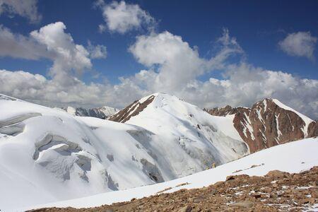 Mountain peak with glacier with blue sky. Kazakhstan, Tian-shan Reklamní fotografie