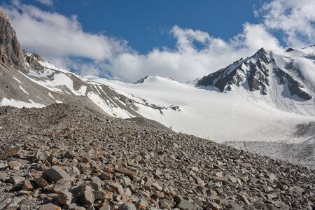 Mountain pass of Popov with glacier with blue sky. Kazakhstan, Tian-shan