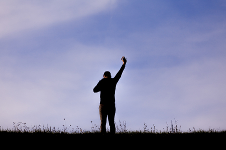 Man Worshiping outside Stock Photo