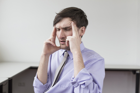 overstress: Businessman with headache in office
