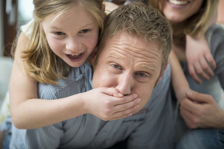 keeping room: Daughter covering fathers mouth with her hand