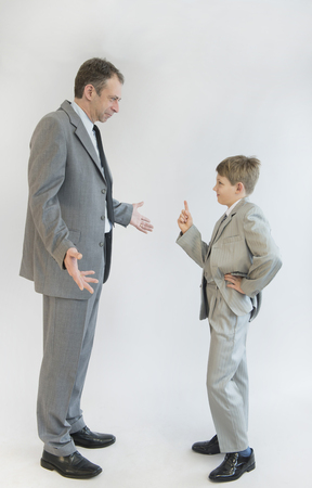 imitating: Son blusters his father against white background