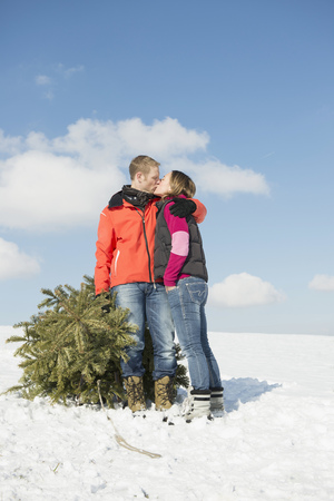 Couple kissing each other with spruce, Bavaria, Germany