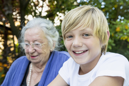 crinkles: Grandmother and his smiling grandson, close-up