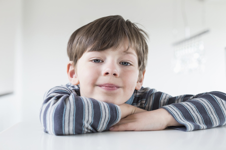 scallywag: Portrait of boy leaning on table, close up
