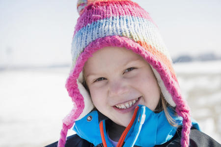 Portrait of girl in winter, smiling, Bavaria, Germany