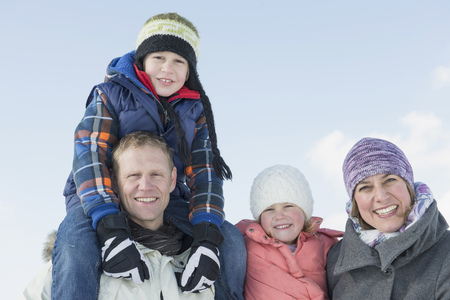 Portrait of family in winter, smiling, Bavaria, Germany LANG_EVOIMAGES