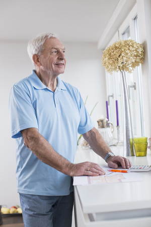 figuring: Smiling senior man looking out of window