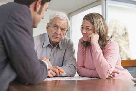 sitting on the ground: Consultant advising couple at home