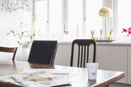 without windows: Coffee cup and newspaper on table