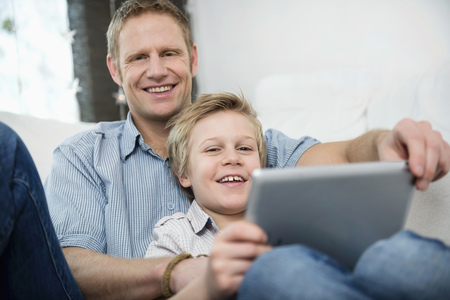 Father and son with digital tablet LANG_EVOIMAGES
