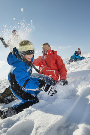 Family having snowball fight, Bavaria, Germany LANG_EVOIMAGES