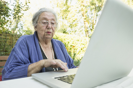 astonishing: Female senior using laptop