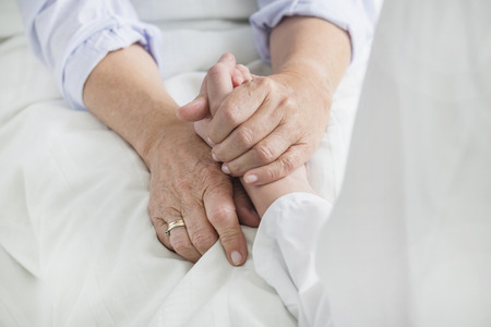 Woman holding patients hand