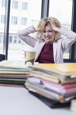 overstress: Businesswoman desperate in office