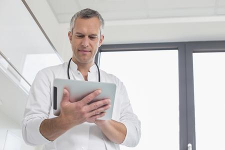 Doctor holding digital tablet, portrait