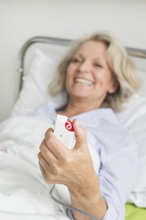 pyjama: Patient in hospital ringing for nurse