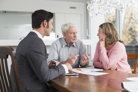 figuring: Consultant advising couple at home
