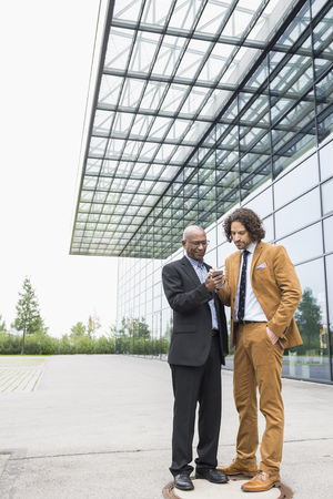 telephone interview: Business colleague two men walking multiracial