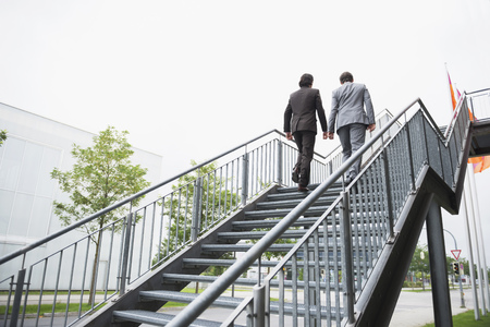 2 way: Businessmen ascent ladder of success job Teamwork