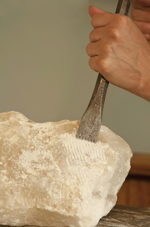 Mature woman carving soapstone