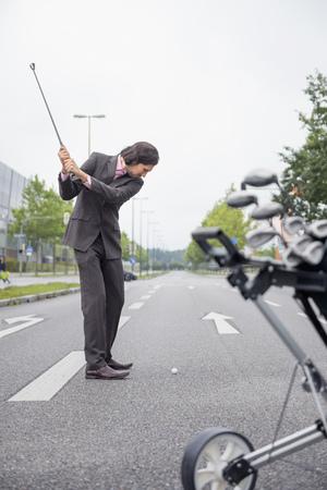 Man Risky road Cross golf deciding Decision goal LANG_EVOIMAGES