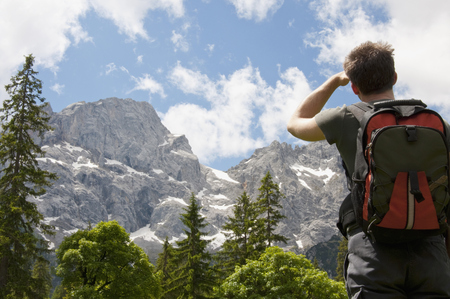 Mountain scenery, Man hiking with backpack, rear view, Karwendel, Austria