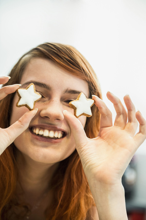 public celebratory event: Close up of a red-haired young woman with cinnamon stars as eyes, Munich, Bavaria, Germany