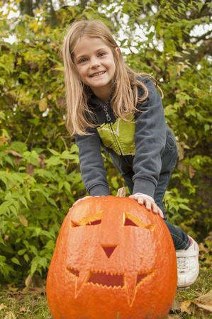 Girl with halloween lantern, smiling, portrait