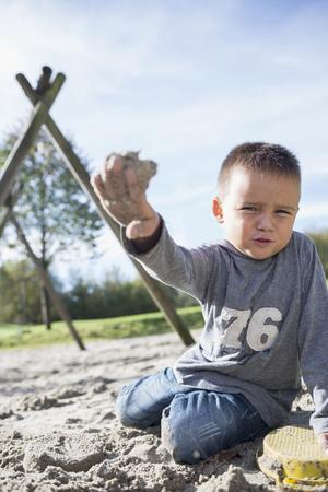 Portrait small boy sand playing sandbox playground