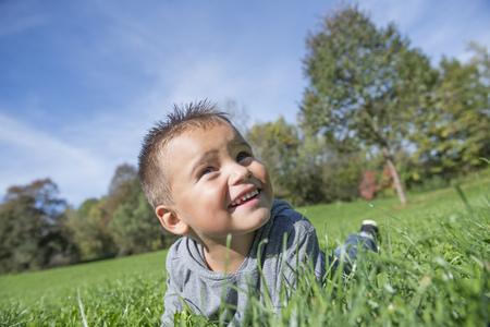 feld: Smiling small young boy meadow fun portrait
