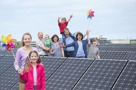 age 10 12 years: Family solar energy windmill smiling future LANG_EVOIMAGES
