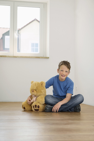 about age: Young boy alone empty room teddy moving home
