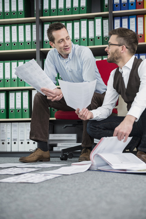 slovenly: Two men office organizing document filing