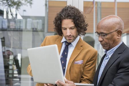 Portrait businessmen laptop computer suit meeting