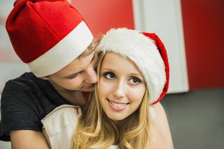 public celebratory event: Young couple romancing on Christmas eve, Munich, Bavaria, Germany