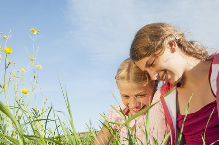 lust for life: Portrait two girls field countryside happy LANG_EVOIMAGES