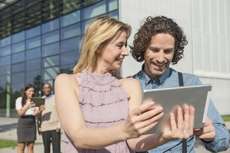 People meeting modern building tablet computer LANG_EVOIMAGES