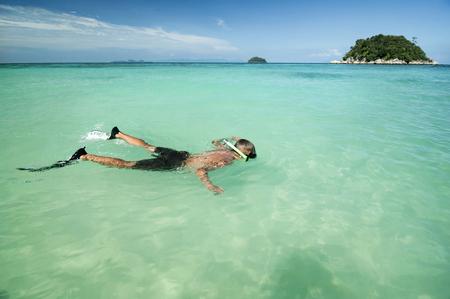 snorkelers: teenage boy snorkeling, Koh Lipe, Thailand
