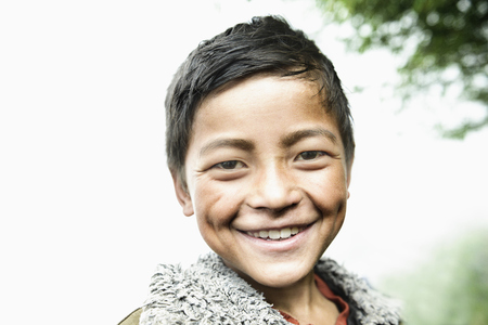 indian subcontinent ethnicity: Portrait of a teenage boy smiling, Nepal LANG_EVOIMAGES