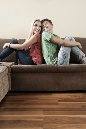 first day: Teenage couple relaxing on couch