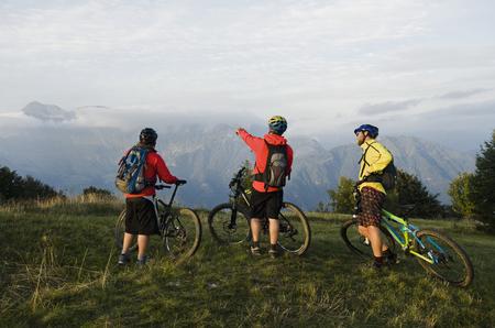 three mountain bikers looking at view, Kolovrat, Istria, Slovenia