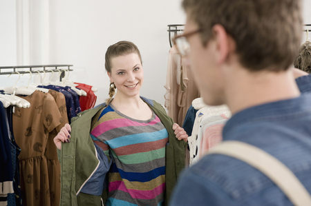 coathangers: Young couple shopping at fashion store