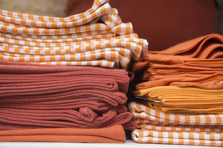 Folded drapery on racks in clothes shop, Augsburg, Bavaria, Germany,  LANG_EVOIMAGES