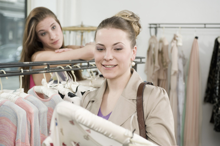 coathangers: Sales girl with customer in fashion store