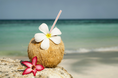 coconut with cocktail at the beach, Koh Lipe, Thailand