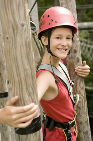 Portrait of girl climbing crag, smiling